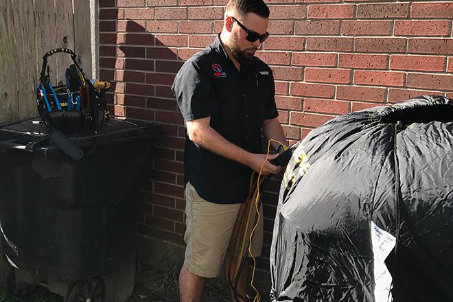 Madd Air HVAC Technician working on a customers AC unit.