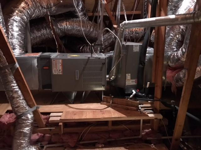 Home furnace with duct work exposed in the attic of a home
