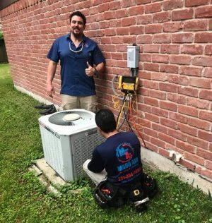 Two Madd Air technicians replacing an AC unit