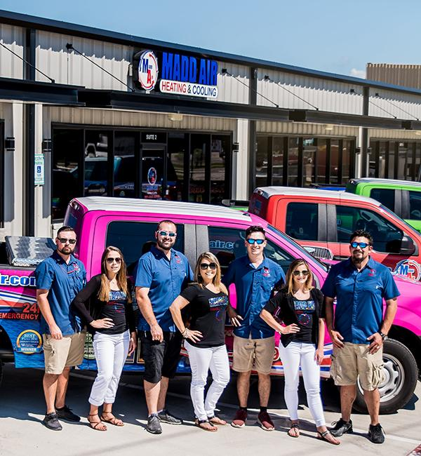 The Madd Air Heating & Cooling office staff standing in front of shop