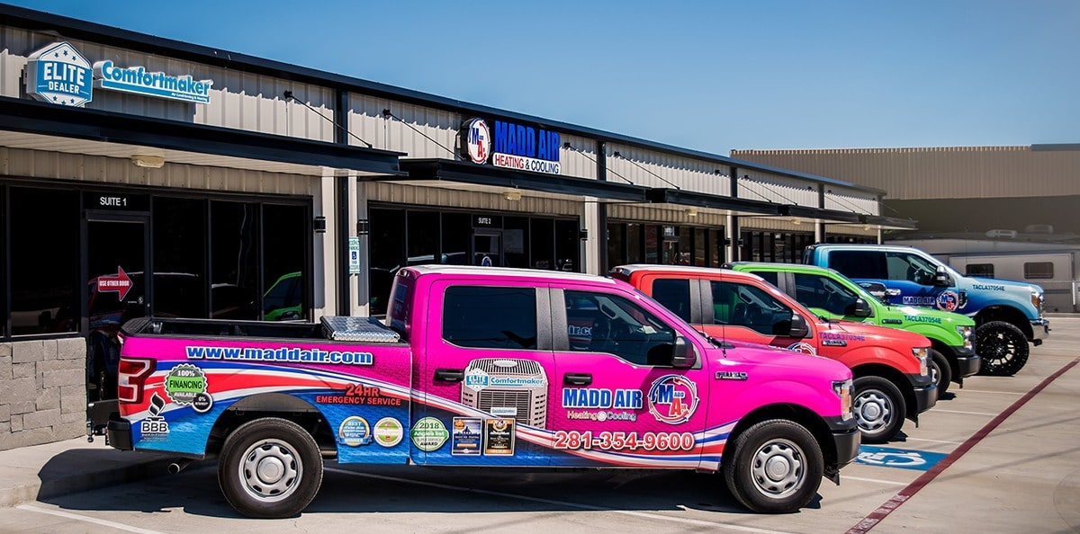 Madd Air Heating & Cooling service fleet in front of shop